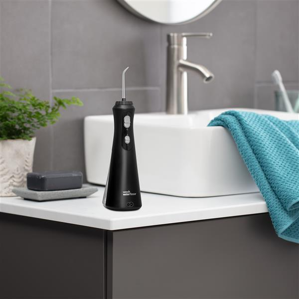 Black Cordless Plus Water Flosser WP-462 In Bathroom