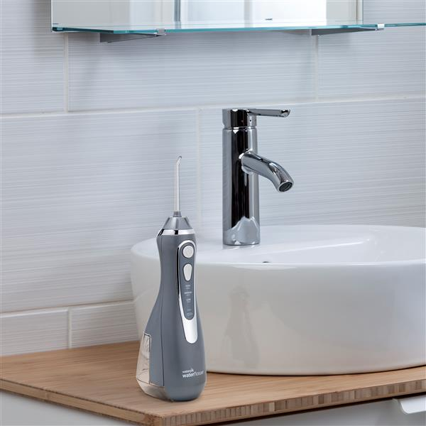 Modern Gray Cordless Advanced Water Flosser WP-567 In Bathroom