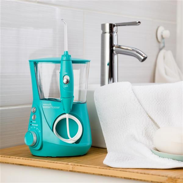 Teal Aquarius Designer Series Water Flosser WP-676 In Bathroom