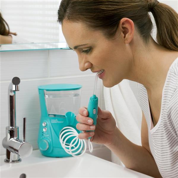 Using WP-676 Teal Aquarius Designer Series Water Flosser