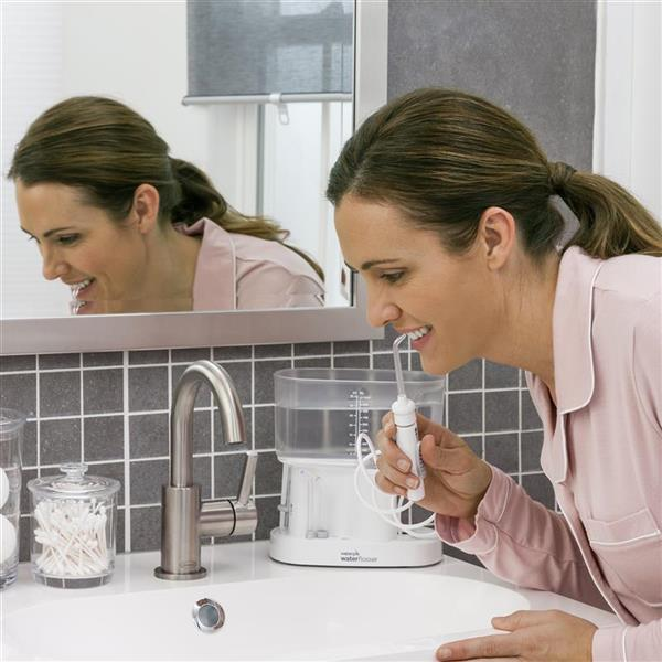 Using WP-72 White Classic Professional Water Flosser