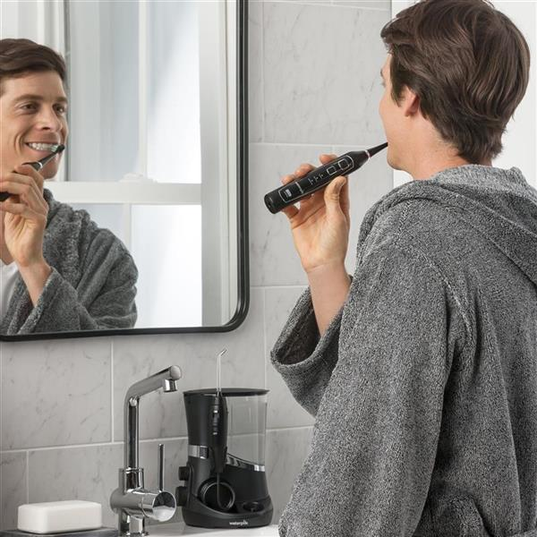 Using Black Complete Care 5.0 Toothbrush