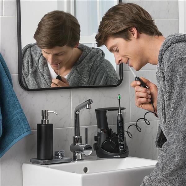 Using Black Complete Care 5.0 Water Flosser Toothbrush