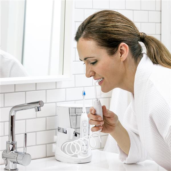Using White Complete Care 5.0 Water Flosser Toothbrush