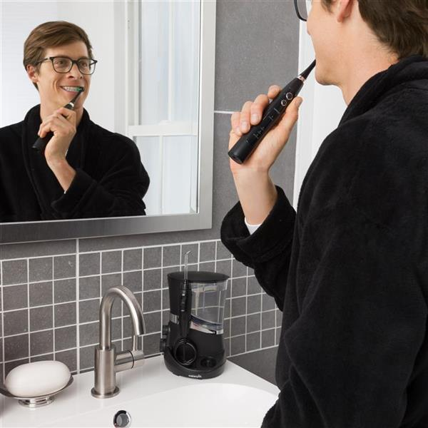 Using Black Complete Care 5.5 Toothbrush