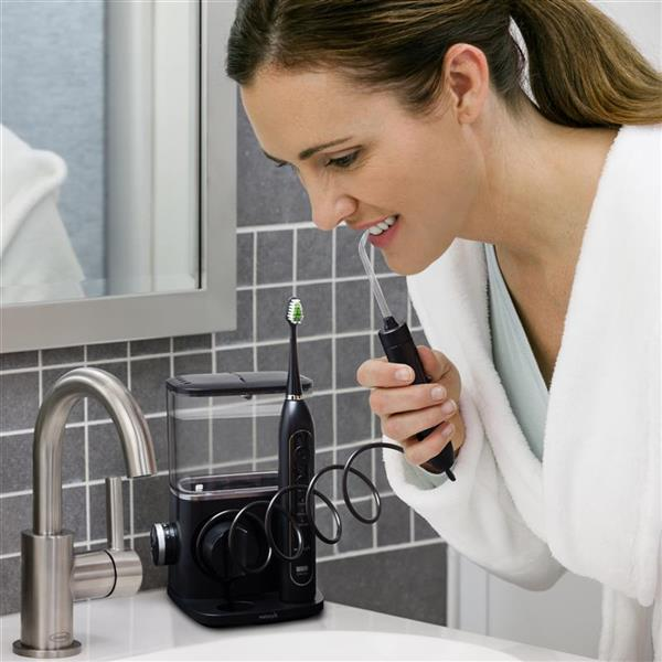 Using Black Complete Care 9.0 Water Flosser Toothbrush