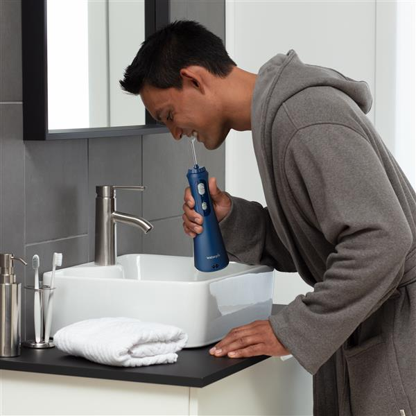 Using WP-463 Blue Cordless Plus Water Flosser
