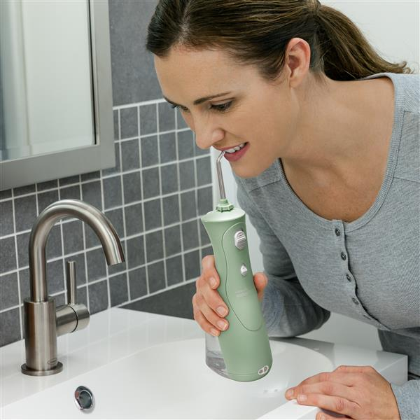 Using WP-468 Mint Green Cordless Plus Water Flosser