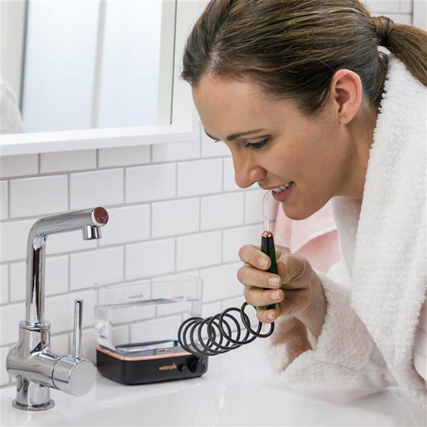 Using WF-04 Black  Sidekick Travel Water Flosser
