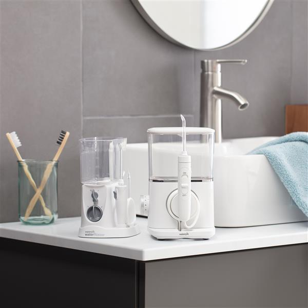 White Evolution Water Flosser WF-07 and Nano Water Flosser WP-310 In Bathroom